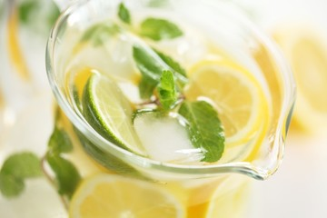 Detail of glass jug with fresh lemonade.