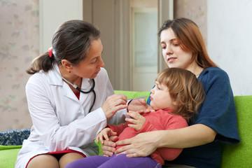 children's doctor examining 2 years child