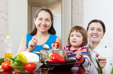 women  with child  cooking veggie lunch