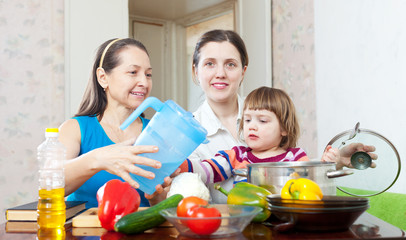 Happy family cook  with vegetables
