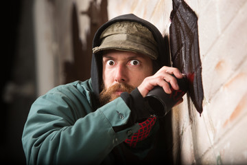 Tense Man Tagging a Wall