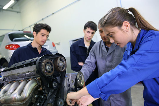 Mechanics training class with teacher and students