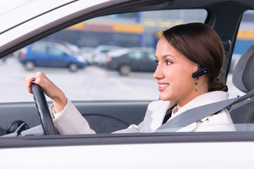 talking phone in a car using a headset