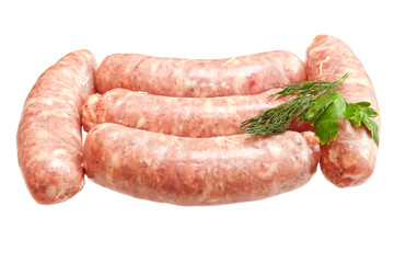 Raw meat sausages with greens isolated on white background