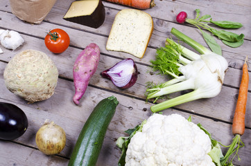 compilation of different vegetables on wooden background