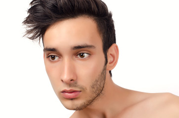 Portrait of a young beautiful man with half face shaved