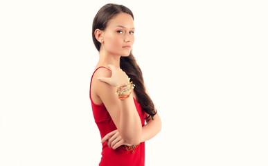 Beautiful brunette woman in red dress posing fashion in studio