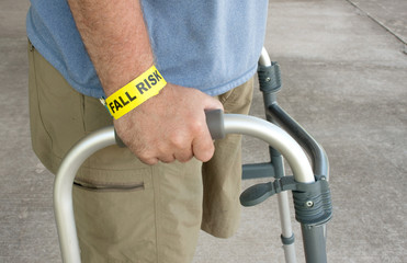 Handicapped Man Wearing A Fall Risk Bracelet