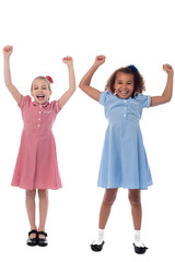 Two excited young girls in joyous mood