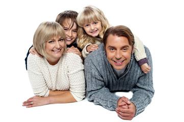 Joyful family of four, studio shot