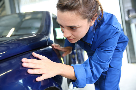 Coachbuilding sudent working on car in repairshop