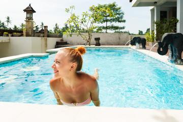 Happy woman in pool