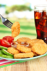 Fried chicken nuggets with vegetables,cola and sauce