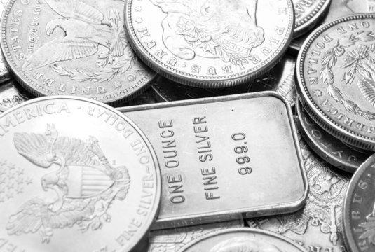 Silver coins and bars macro shot