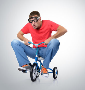 The curious man on a children's bicycle