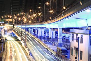 Large urban highway viaduct light trails night scene