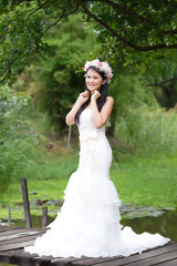 Beautiful Asian lady white bride dress, posing in the forest