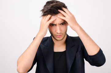 Young beautiful businessman stressed at work