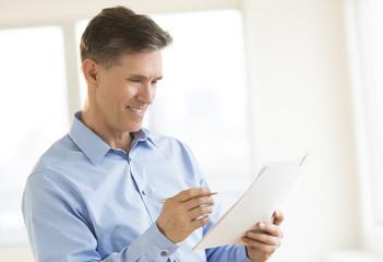 Happy Businessman Reading Document