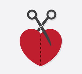 Heart cut in half with scissors