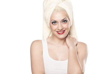 nice and smiling blonde in a shirt with a towel on her head