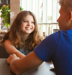 Teens couple in cafe close up portrait