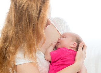 Loving mother woman and her child baby girl