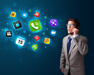 Young man calling by phone with various icons