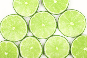 lime slices neatly arranged on a white background