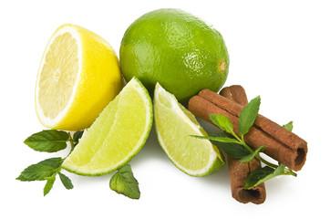 Lime,lemon and fresh leaves of mint on white