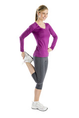 Happy Woman Looking Away While Stretching Leg Muscle