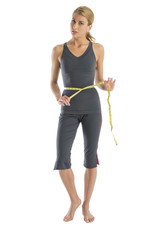 Frustrated Woman Holding Tape Measure Around Waist