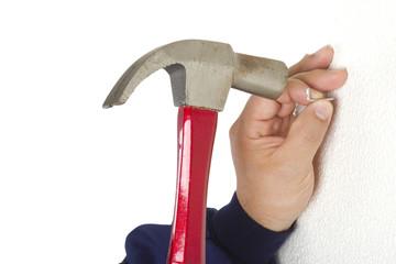 Hand hammering a clove