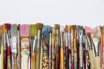 Colourful dirty painting brushes