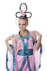 The girl-dancer in a costume of the Japanese