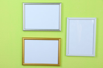 Photo frames on wall background