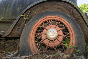 old abandoned car rugged tire