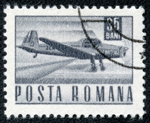 stamp printed in Romania shows a Zlin Z-226A akrobat plane