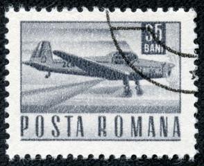 stamp printed in Romania shows a Zlin Z-226A akrobat plane
