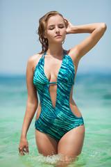 Beautiful woman in bikini at tropical sea