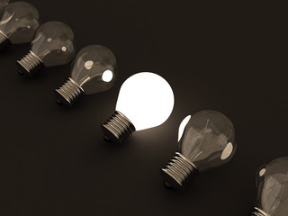 One individual glowing light bulb in others group