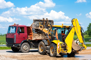 Wheel loader Excavator unloading sand into truck body