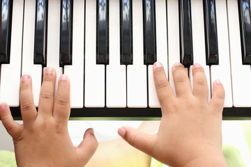 Hand of the boy. Playing the piano