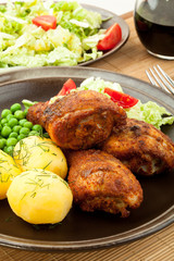 Roasted chicken legs with young potatoes