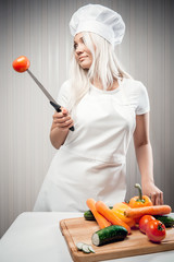 Woman cook with vegetables indoors, diet concept
