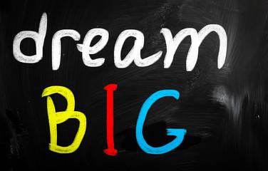 """dream big"" handwritten with white chalk on a blackboard"