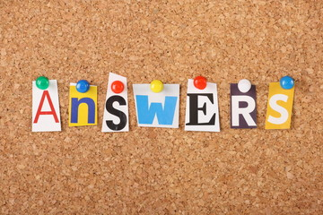 Wall Mural - The word Answers on a cork notice board