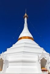 White pagoda in north of Thailand with blue sky background