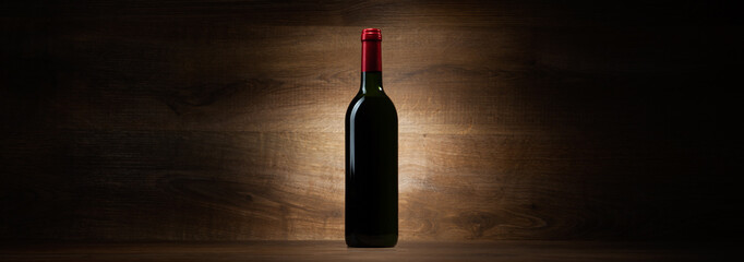 green bottle with red wine on a wood panorama background Fototapete