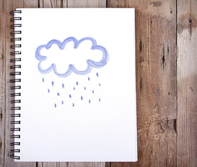 Painting of cloud and rain on notebook